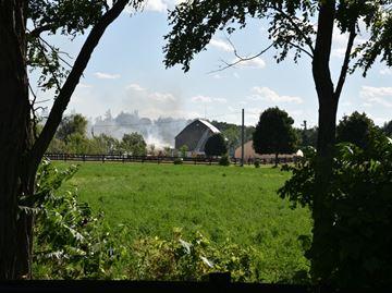 Firefighters battling barn fire in north Burlington