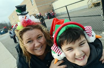 Luisa DiLoreto and son Julian, 9, set off on the Santa Shuffle.