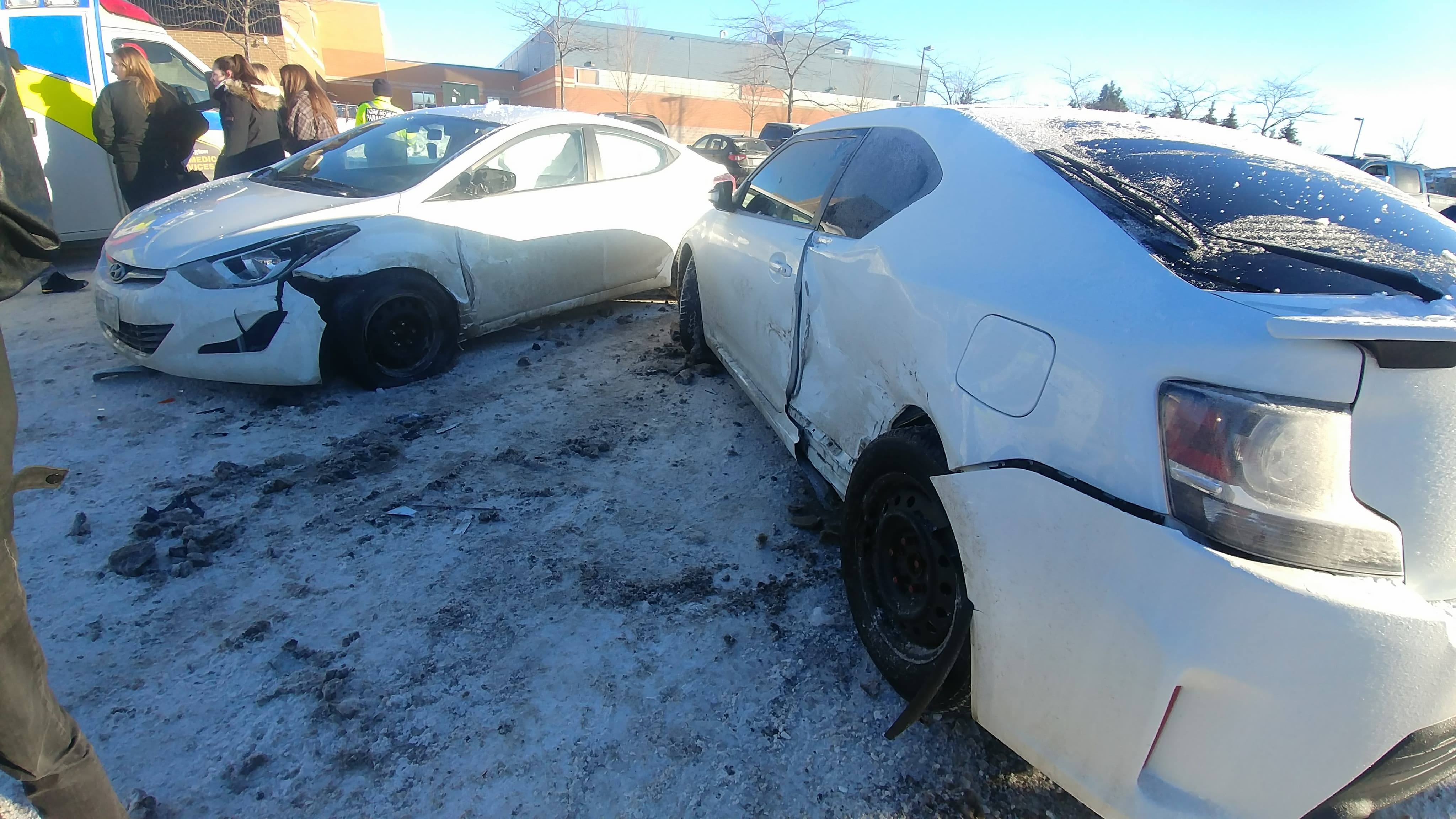 Two white vehicles with minor collision damage