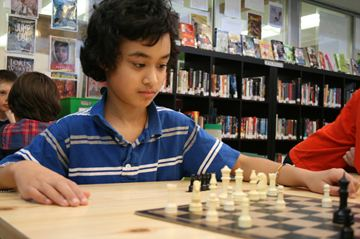 Grade 4 McDougall School student Magnus Rachar, 9, pays close attention during a game of chess against Grade 1 student Hudson Pyykko, 7, on February 26. Magnus and Hudson are part of the school's junior chess club.