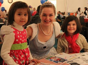 Five-year-old Allison Villamere and nine-year-old Ashley Villamere pose with Cinderella at the Kids Can Fly seventh annual Storybook Breakfast.