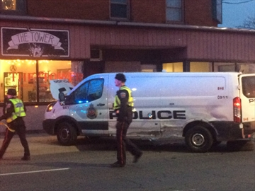 Police attend the scene of a collision between Hamilton officers and another vehicle.