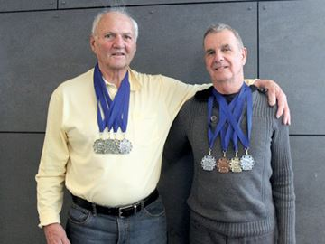 Brian Knight and Aubrey Smith display they medals they won at the OSGA 55+ Swim Invitational. Submitted photo