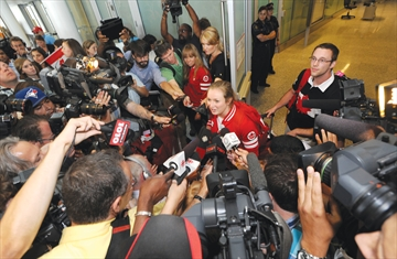 Olympic gold medallist and King City resident Rosie MacLennan was greeted by a media horde at Toronto Pearson International Airport Monday, August 13, 2012.