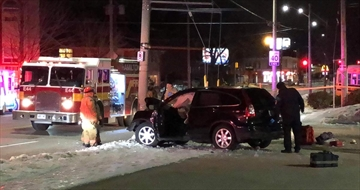 First responders tend to a single vehicle collision on King Street East at Balmoral Avenue South Sunday morning.