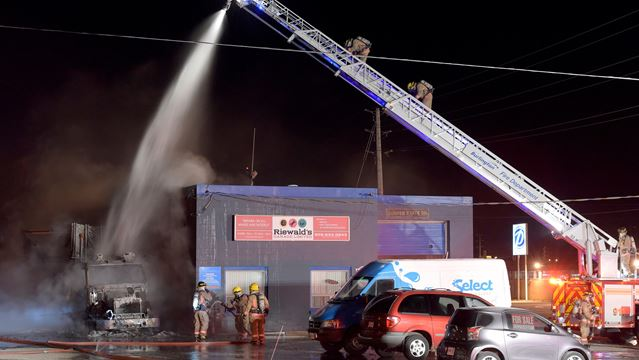 Tractor-trailer fire spreads to auto shop