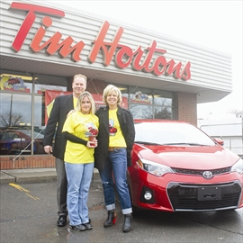 Belleville Tim Hortons owners Mark and Mary Hanley handed over the keys to a brand new 2014 Toyota Corolla to Belleville's Jennifer Davis at Tim Hortons on Front Street In Belleville Tuesday morning, as part of the Roll Up the Rim promotion at the store. Davis won the car after buying a coffee while she was
