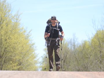 Marc Saulnier, 32, is hiking the nearly 900 kilometre Bruce Trail under the banner 'Blazing the Trail for Sick Kids' to raise money for the hospital's burn unit. The Brampton firefighter emerged from the bush onto Olde Baseline Road in Caledon on May 6.
