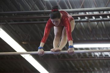 Carolina Bustamante from Birchmount Gymnastics Centre on the uneven bars during the centre's annual Friendship Classic meet March 23.