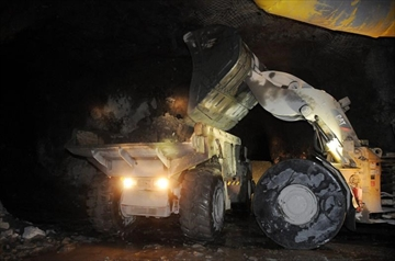 Ore is dropped into a dump truck to be brought to the surface at the 610 foot level of Vale SA garson mine in Sudbury, Ont., Wednesday, Dec. 8, 2010. Unionized workers at the Sudbury Vale mine have voted 85% to accept a collective agreement, ending the first strike at the Sudbury mine in more than a decade. THE CANADIAN PRESS/Gino Donato