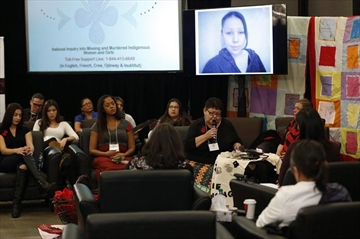 The family of Nicole Daniels speaks to commissioner Michelle Audette at the opening day of hearings at the National Inquiry into Missing and Murdered Indigenous Women and Girls in Winnipeg on October 16, 2017. The National Inquiry into Missing and Murdered Indigenous Women and Girls begins two days of hearings in Moncton, N.B., Tuesday. Commissioner Michele Audette says about 20 family members and survivors are expected to address the hearings. THE CANADIAN PRESS/John Woods