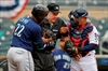 Plate umpire Layne hit in mask, leaves Mariners-Twins game-Image1