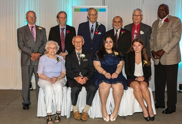 Back row (left): Rick James, Gunther Kraft, Roy Jones, Shuja Qureshi, Ken Dolbear, Albert Graham. Front row (left): Florence Binkley, Walter Decker, Maryam Butrus, Allison Simpson (accepting on behalf of Pat Simpson who was absent).