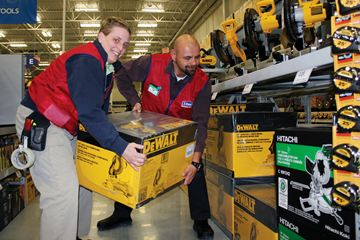 Store staffers Kim Nelson and Sam Vos are busy stocking shelves and getting ready for Lowe's opening this Sunday.