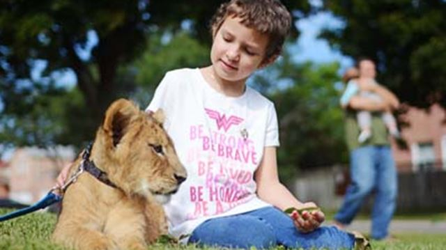 Sarah Watkin with lion cub
