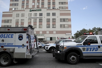 Police vehicles converge on Bronx Lebanon Hospital in New York after a gunman opened fire there on Friday. The gunman, identified as Dr. Henry Bello, used to work at the hospital and apparently took his own life after shooting others, authorities said.