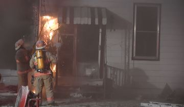 Kawartha Lakes firefighters battle an early Friday morning (Dec. 13) house fire in Omemee that has left a family of five homeless less than two weeks before Christmas.
