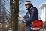 Issa Assal letter carrier