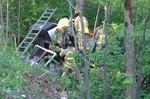 Oakville emergency crews work to free driver of overturned dump truck