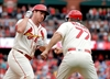 Cardinals push playoff chase to final day, hold off Pirates-Image1
