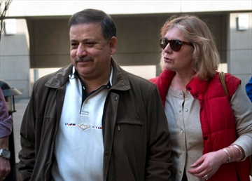 Morteza Jafarpour leaves court in 2012 with his wife Agnes Gizard.