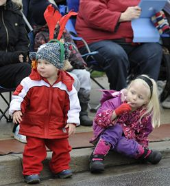 Here, Charlie Small , 22 months  and Leah Jefferson ,5 , strain their necks as they catch a glimpse of Santa.