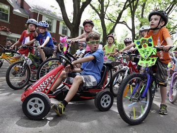 The streets were filled with 'bikers' including Hayden Copping, 9, seated centre, who got on his low rider for a day of fun.