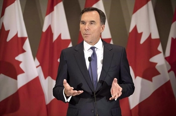 Federal Finance Minister Bill Morneau addresses journalists in Toronto on Thursday August 30, 2018. Finance Minister Bill Morneau is focused more on targeted measures to enhance Canada's competitiveness rather than broad-based corporate tax cuts, sources say. THE CANADIAN PRESS/Chris Young