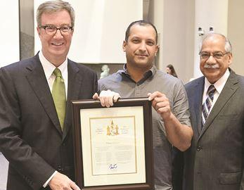 Omar Sultan receives the Mayor's Award