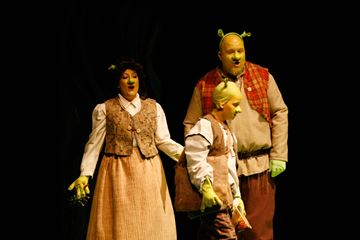 Shrek's parents, played by Jennifer Simpson and Mike Koop, tell a seven-year-old Shrek, played by Jack Koop, it's time to make his own way in the world.