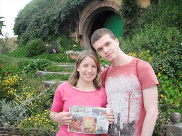 Caillin Hakime with boyfriend Evan Ford o as we stand in front of Bilbo Baggins Hobbit Hole in Hobbiton, in New Zealand.