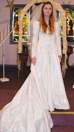 Avory Johnson models a wedding dress at the bridal fashion show presented at the Stittsville United Church last Saturday evening.