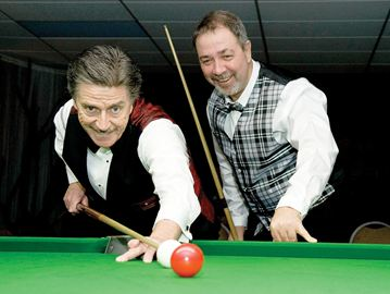 Cliff Thorburn (left) and Bob Chaperon share a smile before last year's final match in the Cambridge Invitational Pro/Am Snooker Tournament. Chaperon won the final 5-1. Both will return to vie for this year's title.