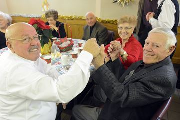 Christmas cheers - Angelo Alberico with new friends Tony and Michelina Juliano, guest at the Oak Ridges Lions Club senior's luncheon.