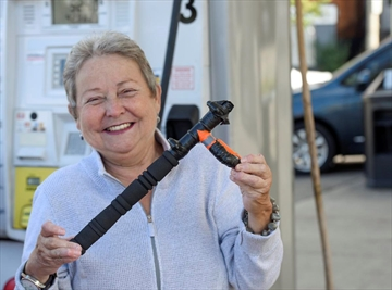 Sandra Mugford with a device that has helped her fill the gas tank on her car more easily despite her painful arthritis.