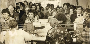 February 1980 — Lineups for 1980 auto licence stickers are growing as Friday's deadline approaches. These people were waiting an average of 25 to 30 minutes at Hamilton's mountain outlet at James and Fennell.