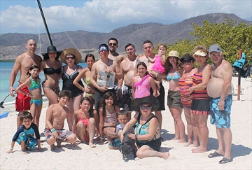 This picture was taken in Manzanillo, Cuba with 21 Milton residents and one Cuban pig named  Panchito!From left to right starting from back row:Martin, Sonia, Carla, Natalie, Ozzy, Andre, Ozzy Sr., Juan, Daniella, Christine, Mary, Janet, Alex Next Row: Bella, Anthony, Isabella, Angelina, Lucas, Julia.