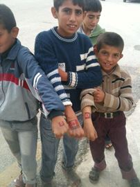 Syrian children show off their Canada tattoos.Photo supplied to This Week