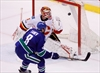Tanev, Canucks beat Flames 2-1 in OT-Image1