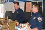 Collingwood firefighters bring presents to Connaught students