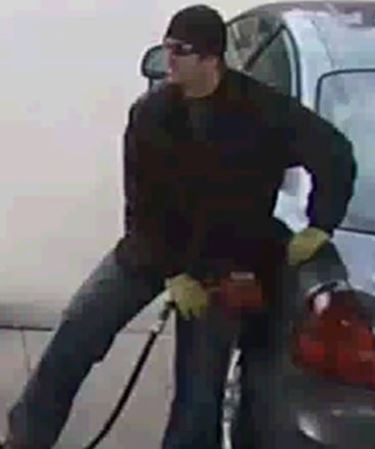 Suspect sought in theft of gas for car with stolen plates