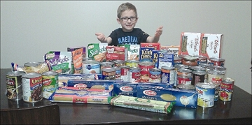 Owen Felske of Belleville celebrated his sixth birthday last week in unusual style. While planning his party his family talked to him about the importance of being thankful for everything they have. After some discussion Owen asked what he could do to help other kids in his community. He then decided he wanted to collect food for the food bank in lieu of presents for his birthday.