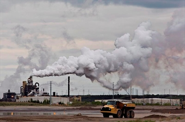 A dump truck works near the Syncrude oil sands extraction facility near the city of Fort McMurray, Alta., on June 1, 2014. Canada would have to cut its emissions almost in half over the next 12 years to meet the stiffer targets dozens of international climate change experts say is required to prevent catastrophic climate changes from the planet getting too warm. The United Nations Intergovernmental Panel on Climate Change says there will be irreversible changes and the entire loss of some ecosystems if the world doesn't take immediate and intensive action to cut greenhouse gas emissions far more than we are now. THE CANADIAN PRESS/Jason Franson