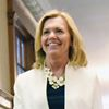 Christine Elliott walking the halls