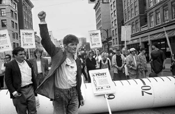 Then-president of Vancouver Area Network of Drug Users (VANDU) Dean Wilson takes part in a protest over HIV and overdose deaths, with a giant syringe in background in this July 18, 2002, handout image. THE CANADIAN PRESS/HO-Elaine Briere, *MANDATORY CREDIT*