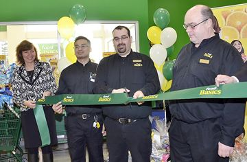 Ribbon cutting at the grand opening of Food Basics in Newmarket on Yonge street. Cutting the ribbon are, Johanne Choinere, Senior VP of Metro Toronto,from left, staff, Ron Enriquez, Newmarket store manager, Bernardo Gallo and Dan Leadle.