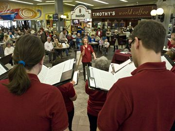 Karen Schuessler directs the group that bears her name in the food court at Cherryhill Village Mall on Saturday (April 12).