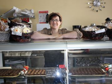 Josie Dorio of Dorio's Bakery shows off her holiday treats as part of Christmas in Kettleby yesterday.
