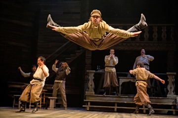 Matt Alfano (centre) as a Russian dancer with members of the company in Fiddler on the Roof.