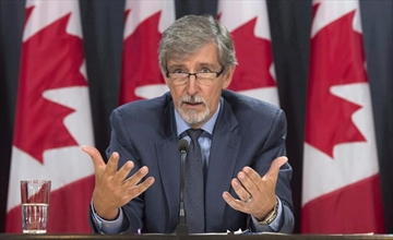 Privacy commissioner Daniel Therrien responds to a question during a press conference Tuesday September 27, 2016 in Ottawa. Canada and the United States have begun sharing information about suspected terrorists under a revamped agreement even though the federal privacy watchdog is still studying the possible risks for Canadians. THE CANADIAN PRESS/Adrian Wyld